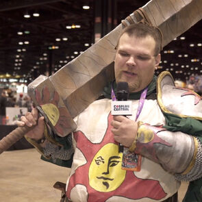 Cosplayer dressed as Solaire of Astora from the Dark Souls video game franchise.