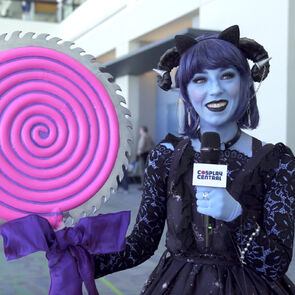 April cosplaying as Jester from Critical Role.