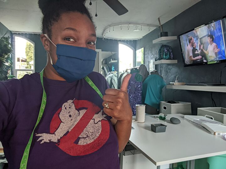Sew Twisted Designs sewing masks inside her new craft studio.