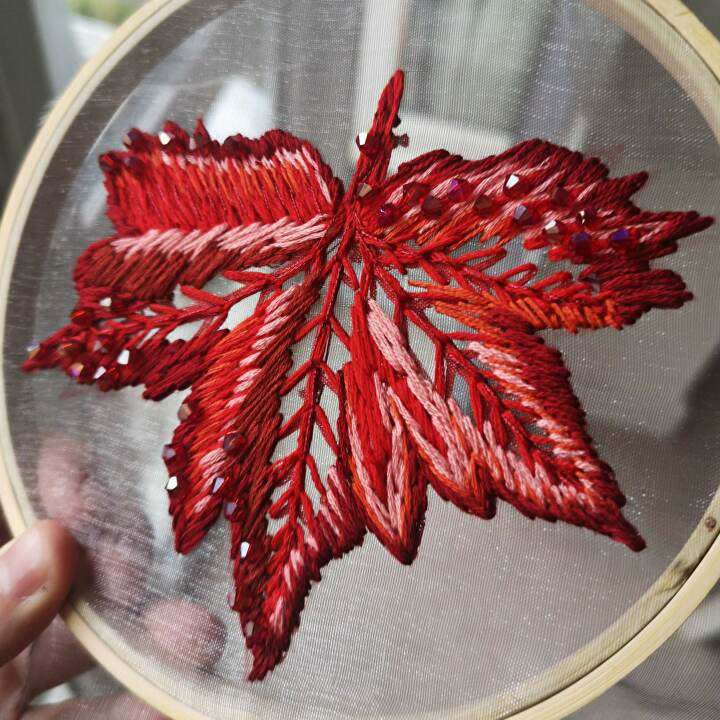 One of the many embroidered leaves for Sansa Stark's coronation gown.