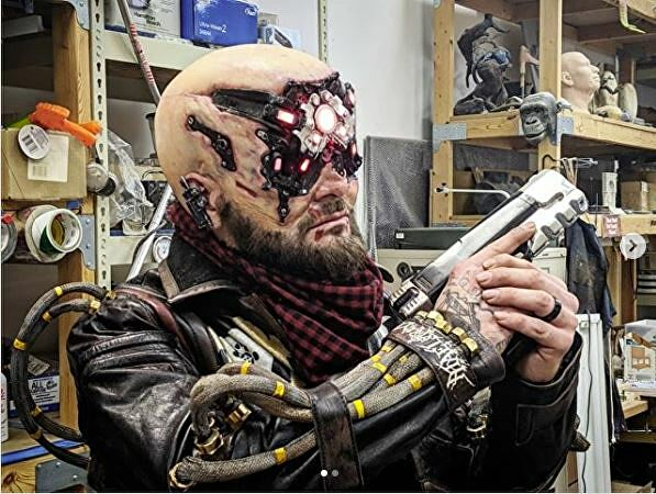 Cosplayer Vulture Productions in his Cyberpunk 2077 cosplay for their cosplay contest.
