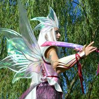 Mizutsune OC by PlexiCosplay using standard fairy wing craftsmanship with wires, cellophane, and brillo board