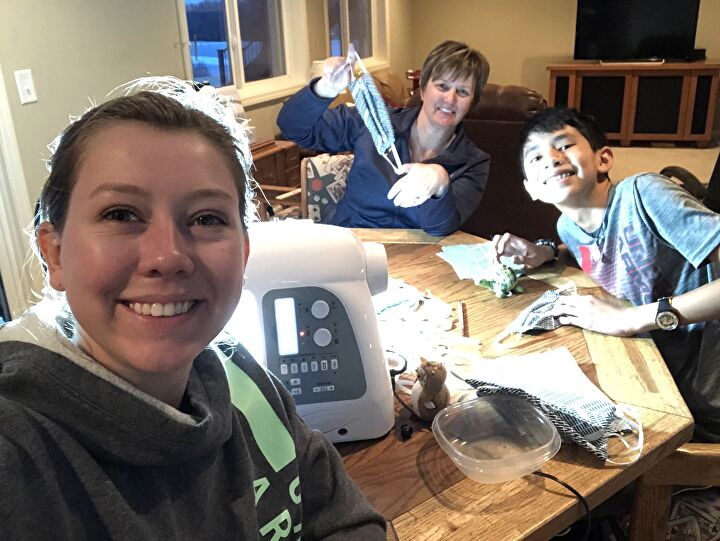 Briena crafting masks with her family.