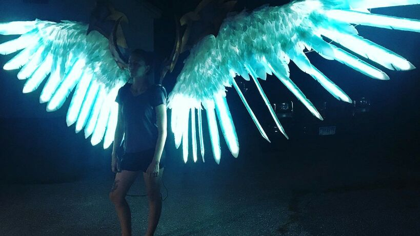 Plexi Cosplay's LED motorized wings for her Pride cosplay from Darksiders.